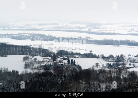 panoramic snowy winter scenery around Waldenburg, a small city in Hohenlohe located in Southern Germany - Stock Photo