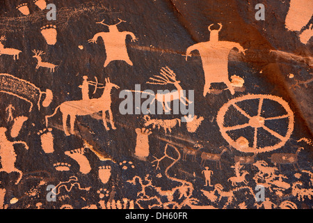 Hunting scene carved into sandstone, petroglyphs, representation of Fremont, Anasazi, Navajo and Anglo-Saxon cultures, - Stock Photo