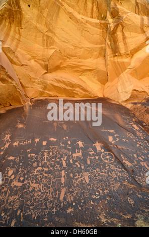 Petroglyphs carved into sandstone, representation of Fremont, Anasazi, Navajo and Anglo-Saxon cultures, prehistoric - Stock Photo