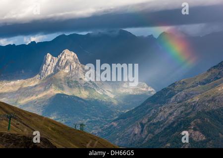 Rainbow over Valle de Tena, Puntal de los petros, Sierra de Tendeñera, - Stock Photo