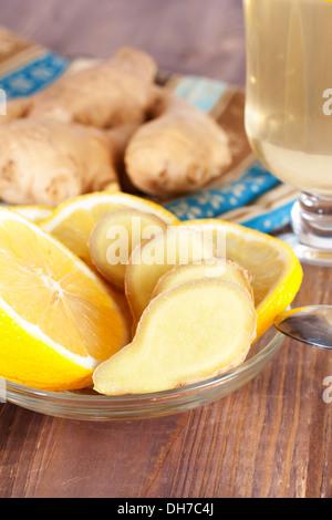 Hot ginger lemon tea in glass - Stock Photo