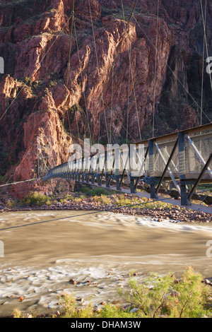 Silver Bridge over the Colorado River on the Bright Angel Trail at the bottom of Grand Canyon National Park, Arizona. - Stock Photo