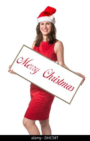 Young woman wearing Santa Claus costume holding a board with the words Merry Christmas, isolated on white background - Stock Photo