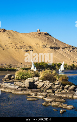 Africa Egypt, Aswan, feluccas on the Nile river - Stock Photo