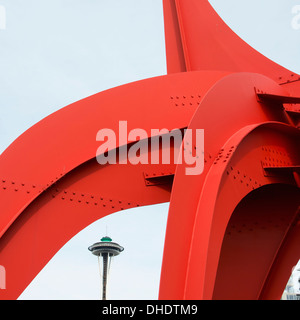 Red Metal Sculpture With The Space Needle In The Distance; Seattle, Washington, United States Of America - Stock Photo