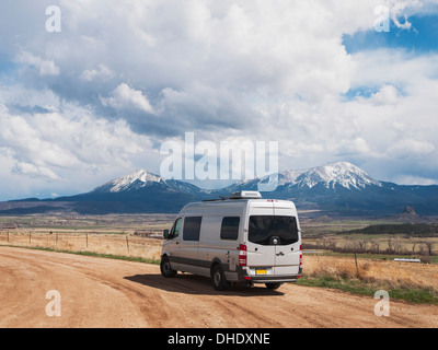 A Camper Parked On A Gravel Road Just East Of Walsenburg, Colorado Looking At Snow Covered East And West Spanish - Stock Photo
