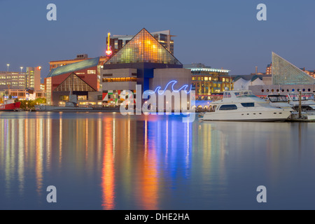 Lights from the National Aquarium reflect off the waters of the Inner Harbor during evening twilight in Baltimore, - Stock Photo