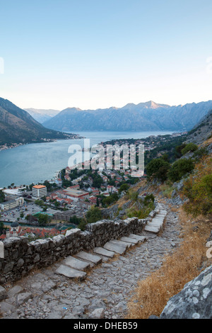 Kotor Old Town and fortifications at sunrise, Bay of Kotor, UNESCO World Heritage Site, Montenegro, Europe - Stock Photo