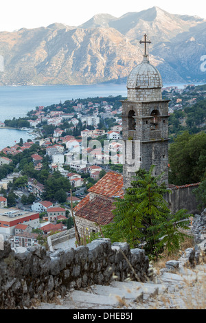 Kotor Old Town and fortifications with the Church of our Lady of Remedy in the foreground, Bay of Kotor, UNESCO, - Stock Photo