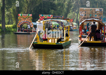 Colourful boats at the Floating Gardens in Xochimilco, UNESCO World Heritage Site, Mexico City, Mexico, North America - Stock Photo