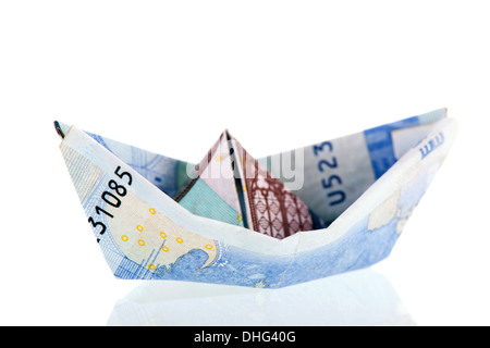 Boat from Euro bank notes isolated over white background - Stock Photo