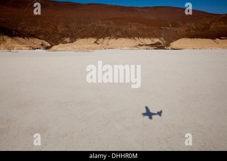 Shadow of aeroplane over Lake Assal, Djibouti, Africa - Stock Photo