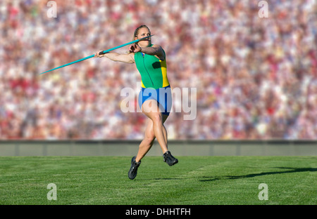 Athlete throwing javelin - Stock Photo
