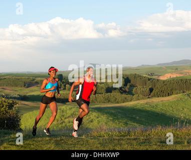 Young couple jogging in landscape, Othello, Washington, USA - Stock Photo