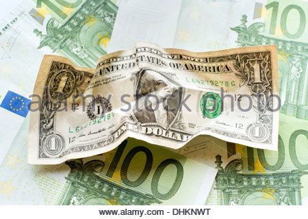 One-hundred Euro bills and an United States Dollar bill - Stock Photo