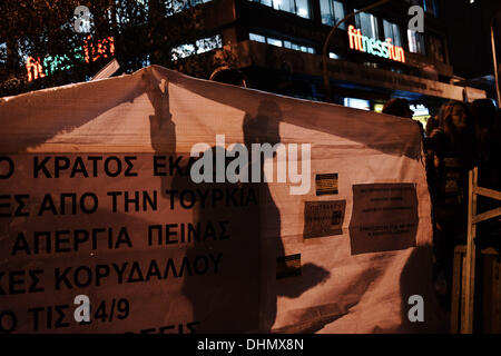 Thessaloniki, Greece. 12th Nov, 2013. A demonstrator holds a banner during the march. Anti racist organizations - Stock Photo