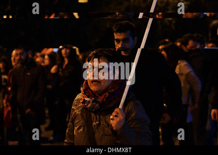 Thessaloniki, Greece. 12th Nov, 2013. A woman shouts slogans while marching. Anti racist organizations and trade - Stock Photo