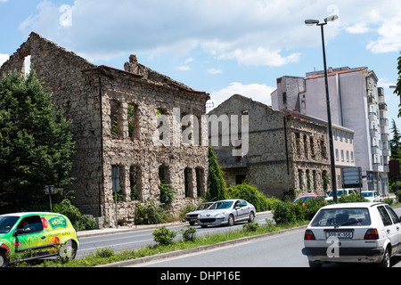 Ruined buildings can be seen everywhere in the town of Mostar. A vivid scar of the 1990s Balkan war between Croats - Stock Photo
