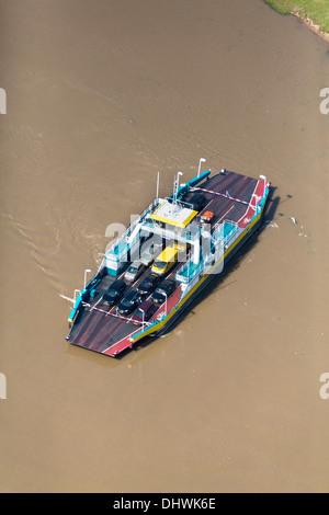 Netherlands, Wijk bij Duurstede, Car ferry crossing Nederrijn river. Aerial - Stock Photo