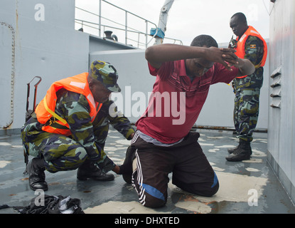 DJIBOUTI, Djibouti (Nov. 14, 2013) - A Uganda People's Defence Force member searches a simulated detainee aboard - Stock Photo