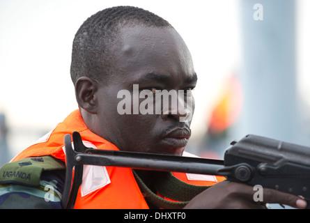 DJIBOUTI, Djibouti (Nov. 14, 2013) - A Uganda People's Defence Force member provides security aboard a target vessel - Stock Photo