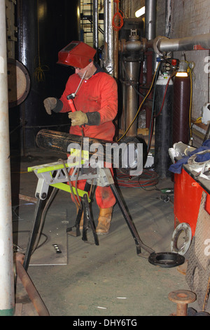 A welder wearing his full personal protection equipment, ppe - Stock Photo
