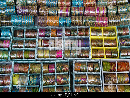 Indian glass bangles on a market stall in India - Stock Photo