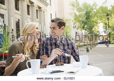 Couple enjoying dessert at outdoor restaurant - Stock Photo