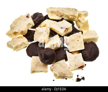 mix from candies of plums in dark chocolate and white chocolate with hazelnuts isolated on white background - Stock Photo
