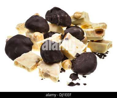 assorted chocolates of plums in dark chocolate and white chocolate with hazelnuts isolated on white background - Stock Photo