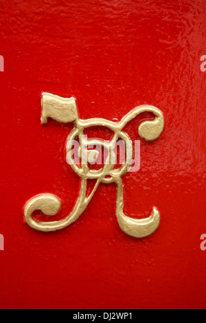 Victorian postbox with VR in gold lettering on it for Victoria Regina, Queen Victoria - Stock Photo