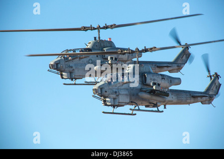 Two US Marine Corps AH-1W Cobra attack helicopters fly in a close air support training exercise October 22, 2013 - Stock Photo