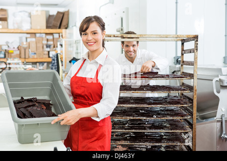 Beautiful Worker Showing Beef Jerky In Basket At Shop - Stock Photo