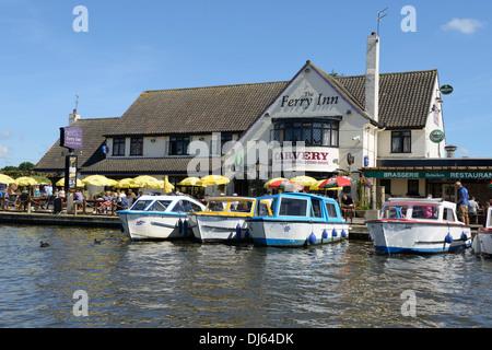 Boats moored on the river Bure beside the Ferry Inn Public House, Horning, Norfolk, England, United Kingdom, UK, - Stock Photo