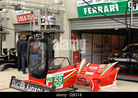 Le Mans pit garage 24 hour race France - Stock Photo