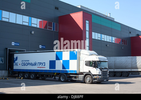 Freight truck of PEK Russian shipping company under loading. Saint-Petersburg, Russia - Stock Photo