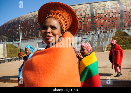 June 11, 2010 - Johannesburg, GAUTENG, SOUTH AFRICA - Women dressed in traditional African clothing walk outside - Stock Photo