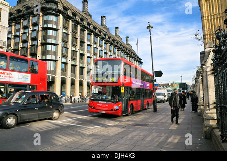 London bus passing Portcullis House and Westminster Underground Station, City of Westminster, London, England, UK - Stock Photo