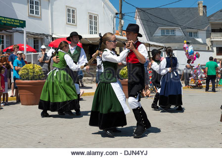 Young people performing traditional folk dance during annual fiestas, Corrubedo, Galicia, Spain - Stock Photo