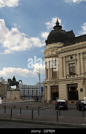 The Central University Library with statue of Carol I, first king of Romania, in front, Bucharest, Romania - Stock Photo