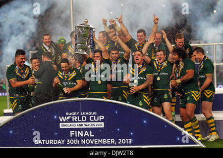 Manchester, UK. 30th Nov, 2013. Team Australia lift the trophy and celebrate winning the Rugby League World Cup - Stock Photo