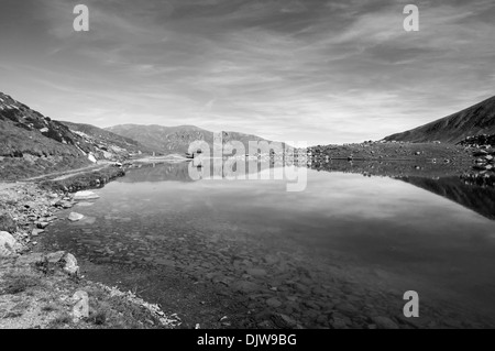 Landscape of a lake in the high mountains in Andorra La Vella on a black and white - Stock Photo