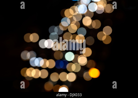 colored circles on a dark background bokeh - Stock Photo