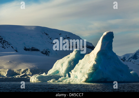 Antarctica, Morning sun lights iceberg floating near Enterprise Island along Wilhelmina Bay along Antarctic Peninsula - Stock Photo