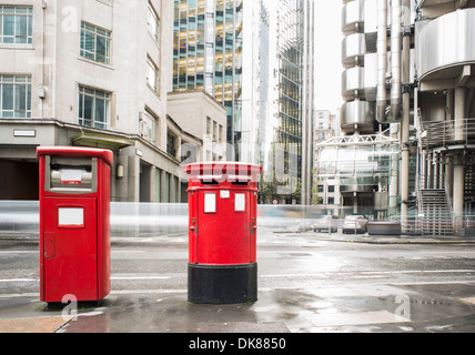 English style red mailboxes vintage buildings - Stock Photo