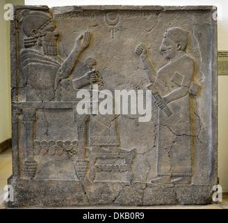 Hittite art. Orthostat or stele of King Bar-Rakib (Barrakit 744-727 BC) sitting on the throne .750 BC. Detail. Turkey. - Stock Photo