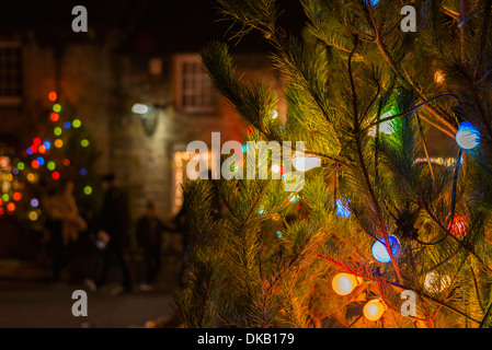 Christmas tree lights switched on in the Peak district village of  Castleton Derbyshire England - Stock Photo