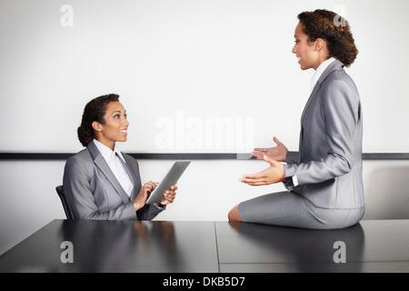 Businesswomen in office, multiple image - Stock Photo