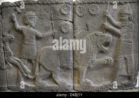 Hittite art. Orthostat. 8th century BC. Relief: Hunting a lion. Found in old city of Sma'al /Zincirli (Turkey). - Stock Photo