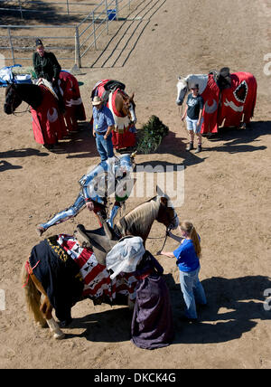 Oct. 22, 2011 - Poway, California, USA -  A knight mounts his steed at the Fifth Annual Tournament of the Phoenix - Stock Photo